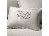 Logo izšūšana uz gultas veļas